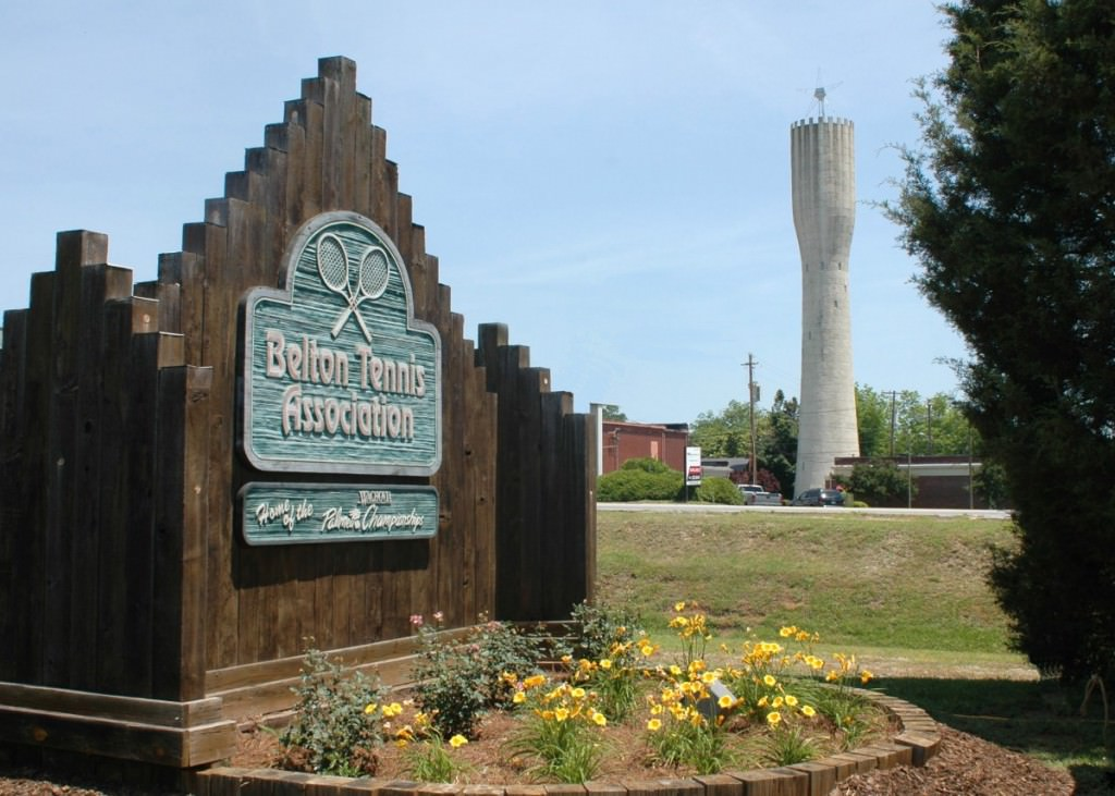 Belton Tennis Center sign with historic Standpipe in the background